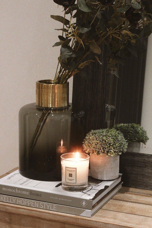 Hilary Robertson Monochrome Home  -  Kelly Hoppen Style  -  Zara Home Vase  (similar)   -  Rose & Grey Natural Eucalyptus Spray  -  Abigail Ahern Cosmos Sprig  - Olivia Blake Wild Pumpkin & Nutmeg Candle  (bought from homesense)