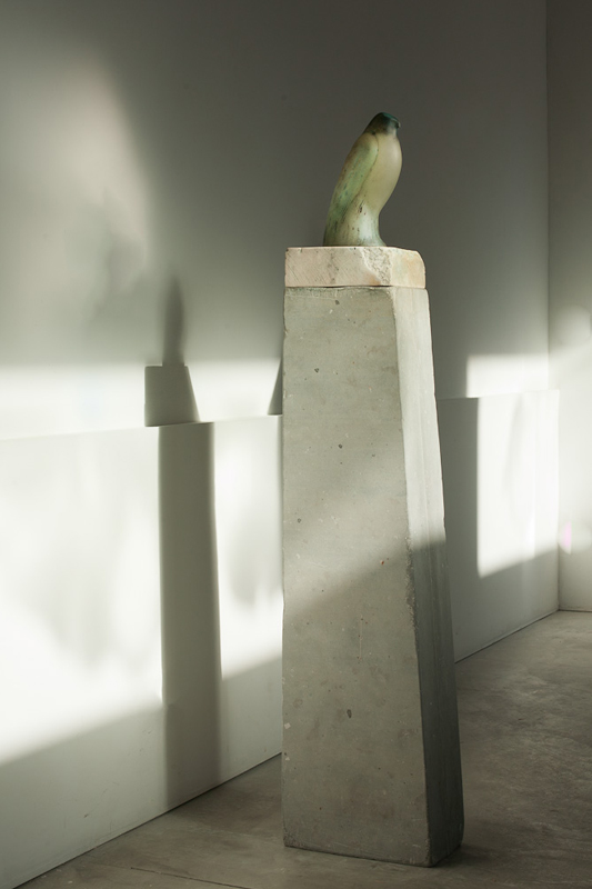 """Celadon Bird,"" 2011 Hand blown pigmented glass and limestone 63 x 8 x 14 inches"