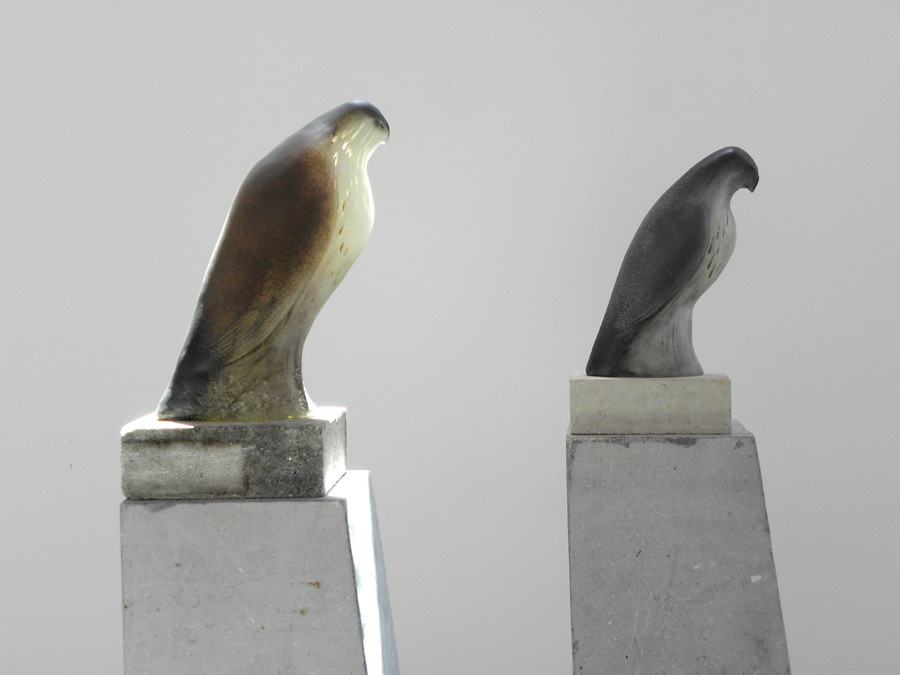 """Monk Birds,"" 2010 Hand blown pigmented glass and limestone 64 x 8 x 14.5 inches (each)"