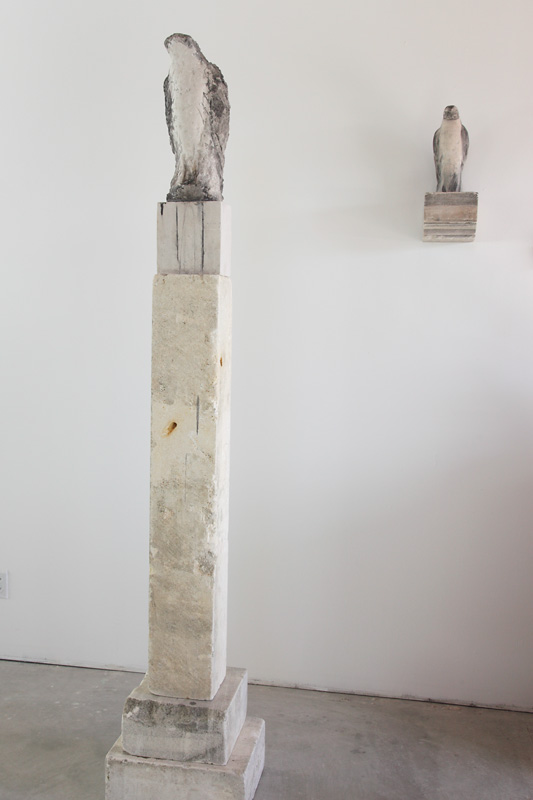 """""""Clock Tower,"""" and """"The Bird I Saw,"""" 2009 Limestone and pigment 85 x 16 x 14 inches"""