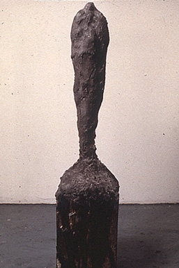 """Black Monk,"" 1989 Mixed media 40 x 9 x 8 inches"