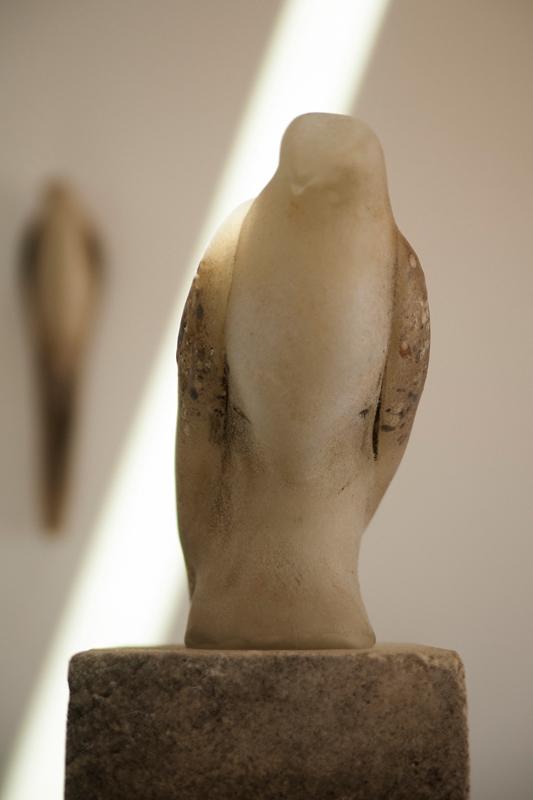 """Soft White Bird,"" 2013 Hand blown pigmented glass & limestone 69 x 8 x 10"
