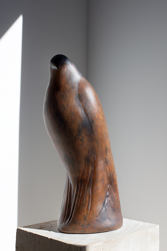 """Cinnamon Bird,"" 2015 Hand blown pigmented glass on limestone 61 x 8 x 12 inches"