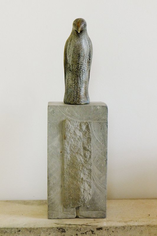 """Braided Hawk,"" 2014 Hand-blown pigmented glass and grey limestone 27 x 8 x 9 inches figure: 12 x 4 x 8 inches"