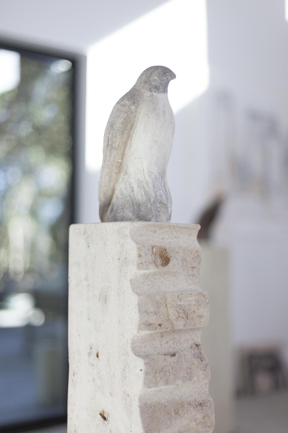 """White Bird on Ladder,"" 2017  Fossil limestone  56 x 10 x 6 inches"