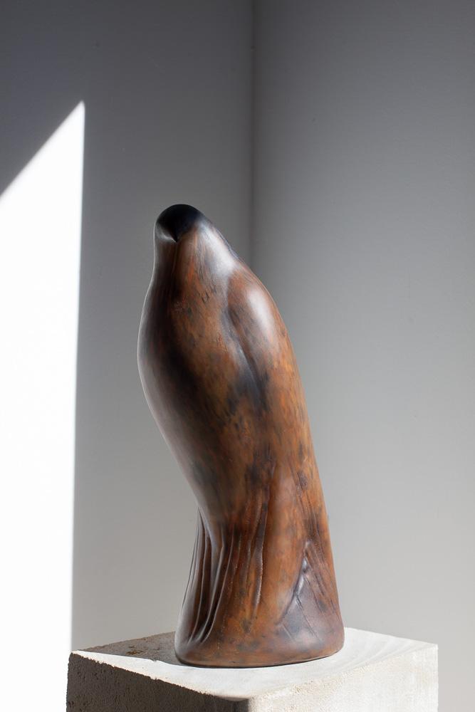 Cinnamon Bird, 2015  Hand blown pigmented glass on limestone   61 x 8 x 12 inches