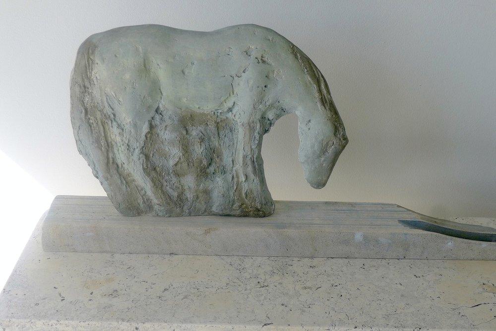 Blue Cash Cut Out, 2016  Unique patina bronze and limestone  15 x 31 1/2 x 4 1/2 inches