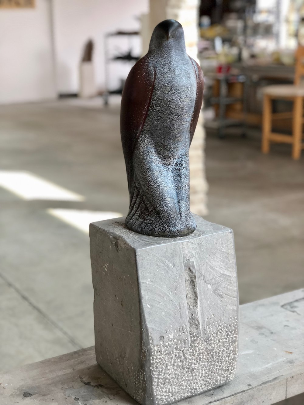 """Dancing Picasso,"" 2018  Hand blown pigmented glass on grey limestone  14.5 x 6 x 6 inches"