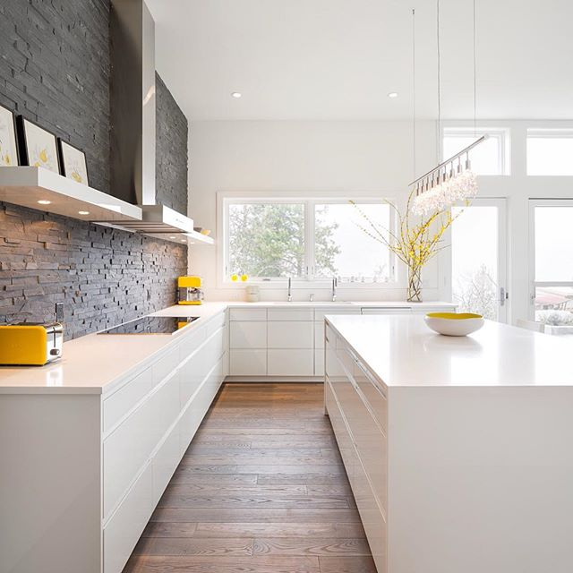 We at tkb love a beautifully designed contemporary environment when we see one. This kitchen is simply spectacular; combining a textured gray backsplash with clean white cabinets and countertops, complemented by a rich, lightly stained floor and subtle yellow accents in the room. This is our inspiration. . . . . #tribecakb #elegant #luxury #interiordesign #newyork #marble #tile #bathroom #kitchen #kitchen&bath #sophisticated #modern #contemporary #rich #remodeling #tribeca #designer #archidigest #architecture  #building #black #nyc #brookyln #lifestyle