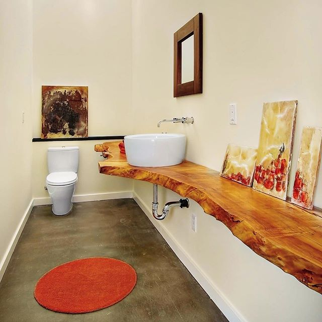 This spacious powder room features an elegant sink supported by a truly unique natural wooden countertop. This is our inspiration. . . . . #tribecakb #elegant #luxury #interiordesign #newyork #marble #tile #bathroom #kitchen #kitchen&bath #sophisticated #modern #contemporary #rich #remodeling #tribeca #designer #archidigest #architecture  #building #black #nyc #brookyln #lifestyle