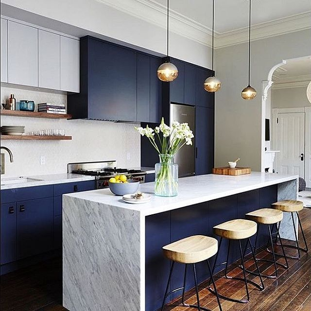 We truly enjoy seeing beauty in every setting. This continuous white and grey countertop, the centerpiece of the setting, simply shines on the stage that is the kitchen. It's complemented by a two-toned cabinetry setup with an exquisite dark blue and muted white. Add the dark brown stains of the wood floor and shelves, and you have created beauty that rivals the greatest of artistic masterpieces. This is our inspiration. . . . . #tribecakb #elegant #luxury #interiordesign #newyork #marble #tile #bathroom #kitchen #kitchen&bath #sophisticated #modern #contemporary #rich #remodeling #tribeca #designer #archidigest #architecture  #building #black #nyc #brookyln #lifestyle