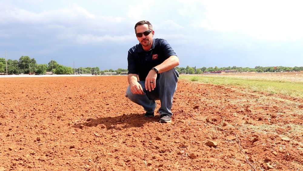 Brian Arnall, an assistant professor at OSU who specializes in precision technologies and soil and crop nutrient management, is pictured in a farm field. [Photo provided by Wheat Squared]