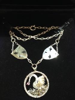 Lorelei Pelican   Sterling silver, 14 kt gold, diamonds, rubies & emeralds.