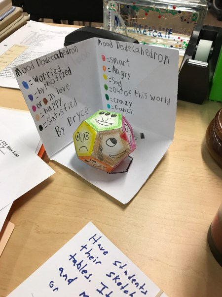 A dodecahedron a 5th grader in my novel group made while we read The Phantom Tollbooth. He went the extra mile to color code it too.
