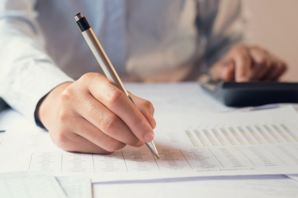 How Tax Preparers and Bookkeepers Work Together.jpg