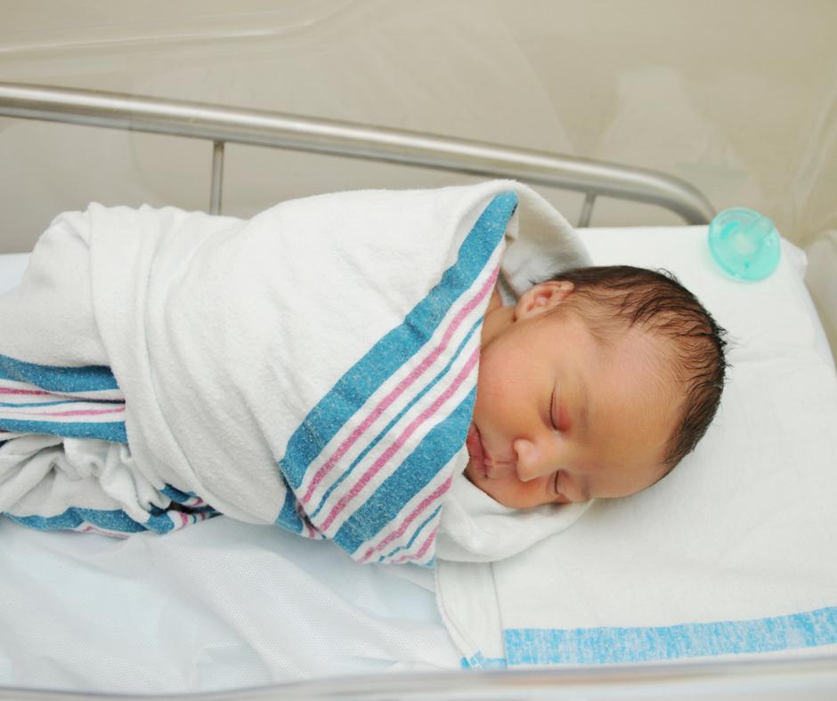 Baby in hospital blanket.png