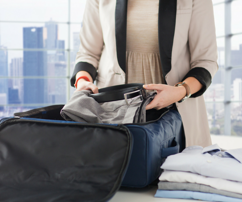 woman packing suitcase