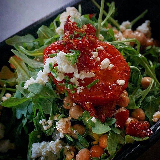Baby Arugula Salad with Hot Coppa Cracklins, Roasted Tomato, Marinated Garbanzo Beans, Goat Cheese, and Pimenton Vinaigrette.