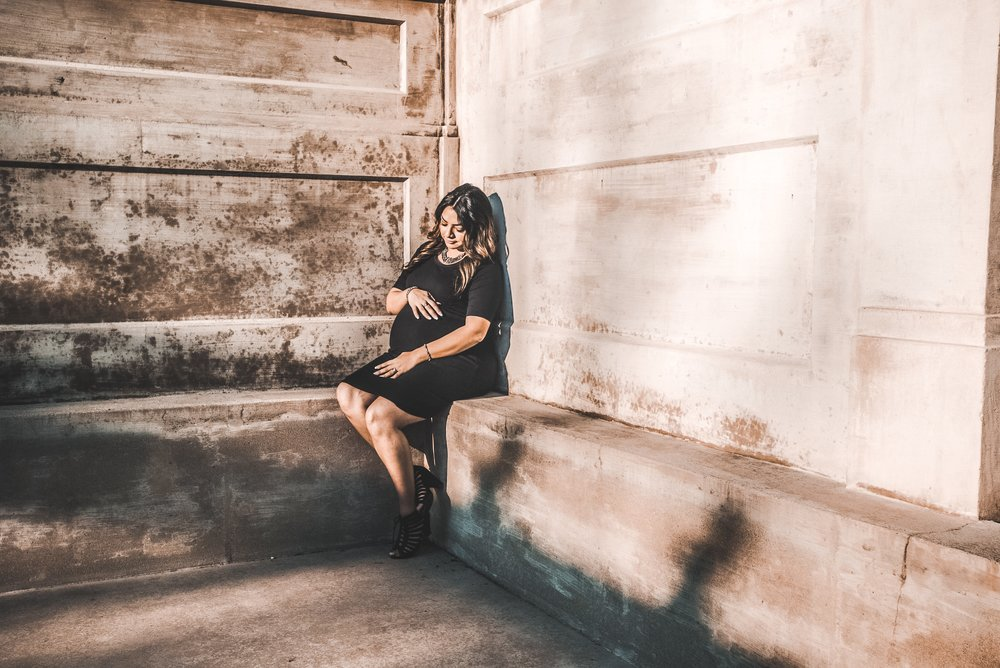 chris-benson-362132-unsplash pregnant woman in corner.jpg