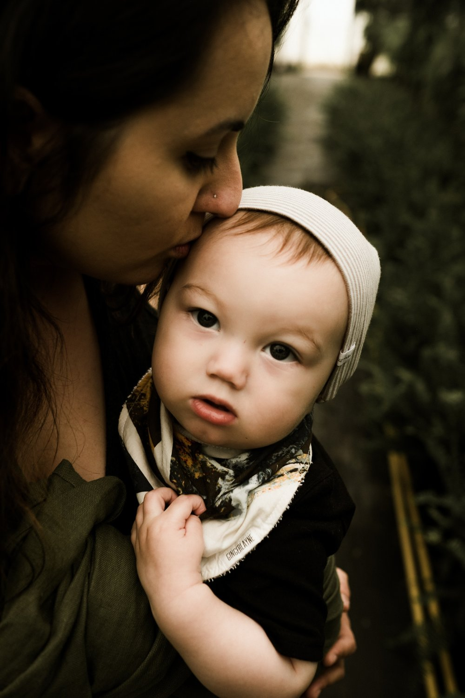 tanja-heffner-248236-unsplash mother w baby looking to lens.jpg
