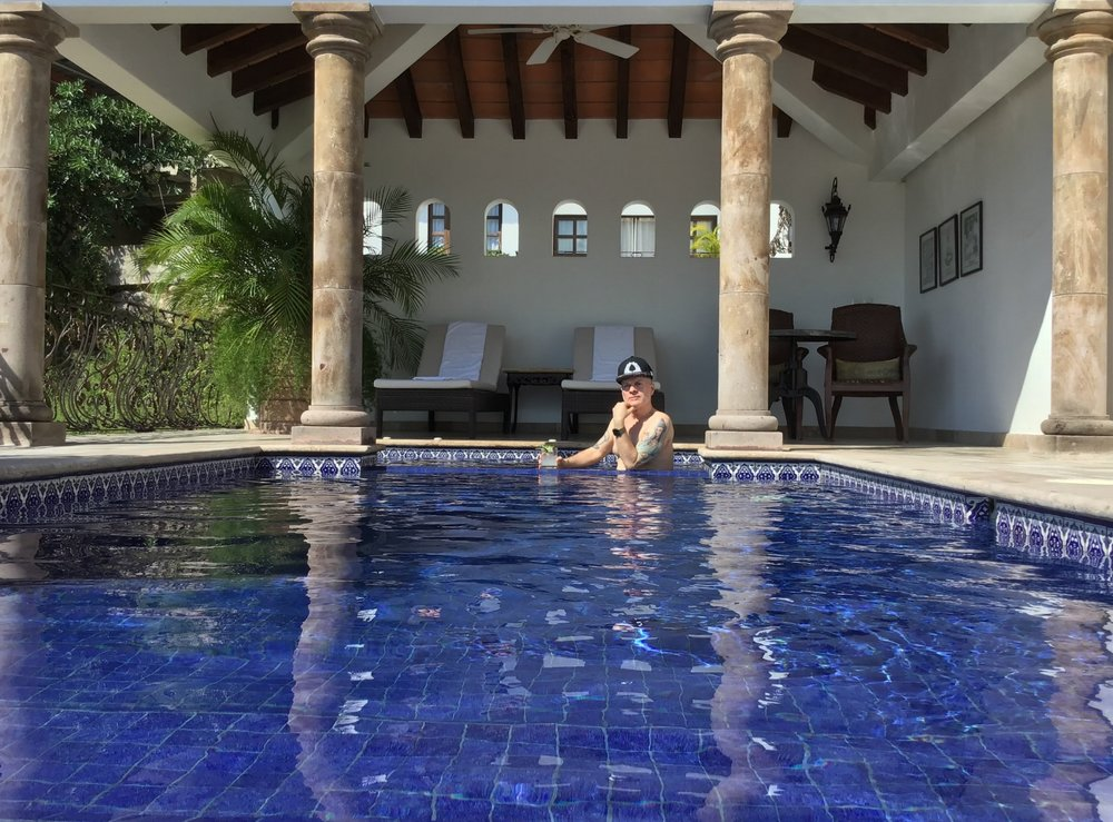 Me chilling in the waters of Elizabeth Taylor's swimming pool in Puerta Vallarta in September. 💦💦💦