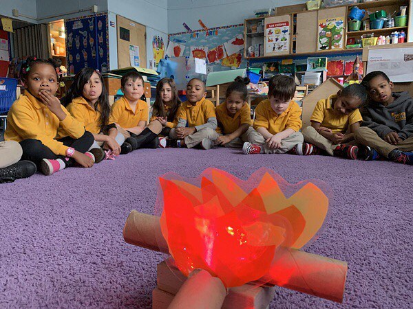 PreK moved into their light unit last week. So naturally they had story time around a camp fire 🔥 . . . #welovebccs #unitsofstudy #joyfullearning