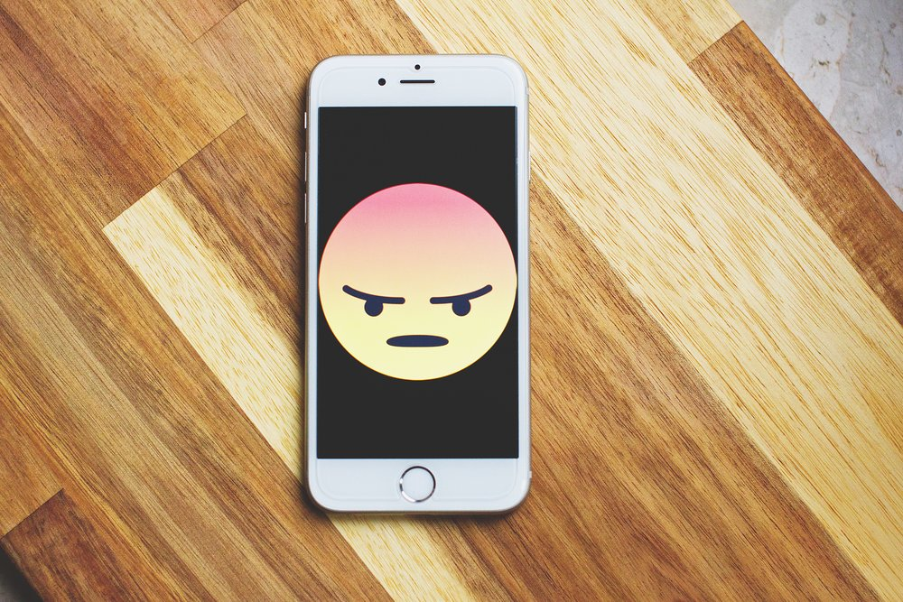 Angry emoji on a silver iPhone 6