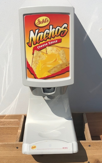 Nacho Cheese Dispenser  - $40 + tax  Includes one package of cheese. Paper trays and packages of cheese available for an additional fee.