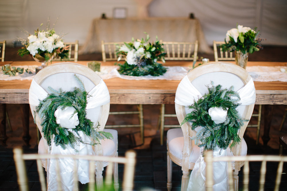 Wreath wrapped sweetheart chairs