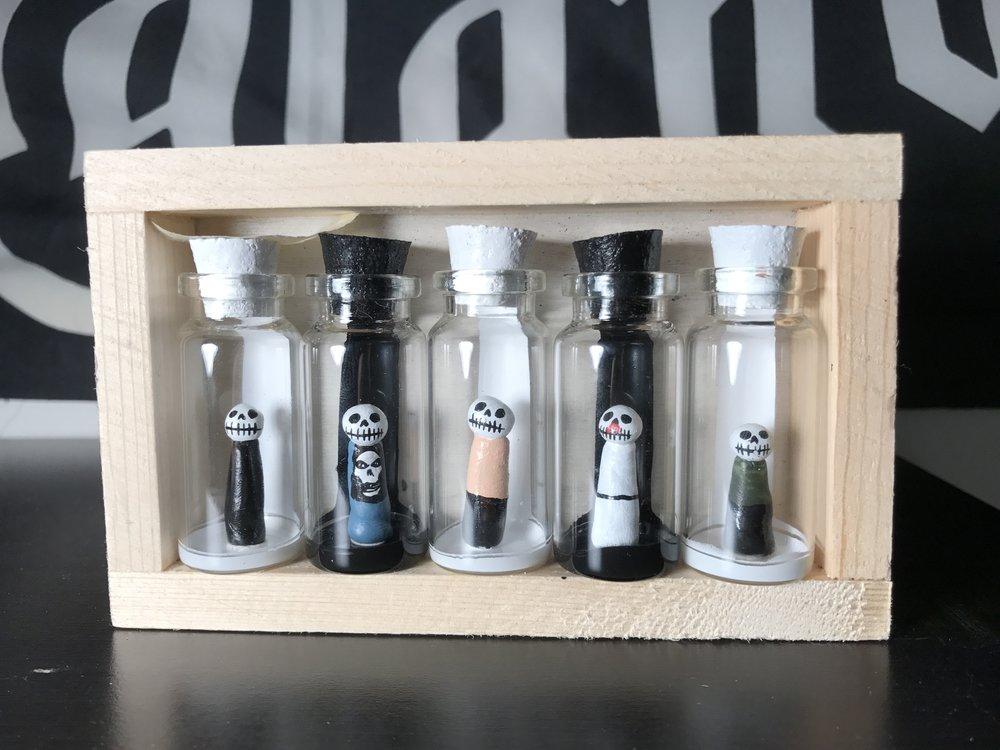 Muertos in large jars