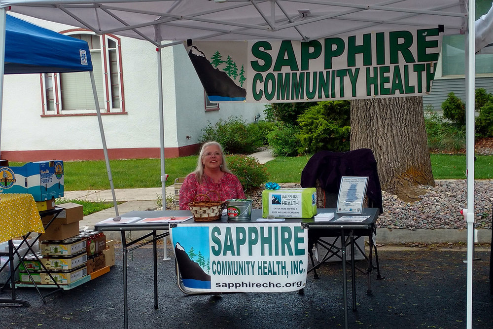 Patty West, Sapphire Community Health Board member at our booth at the Hamilton Farmers Market.