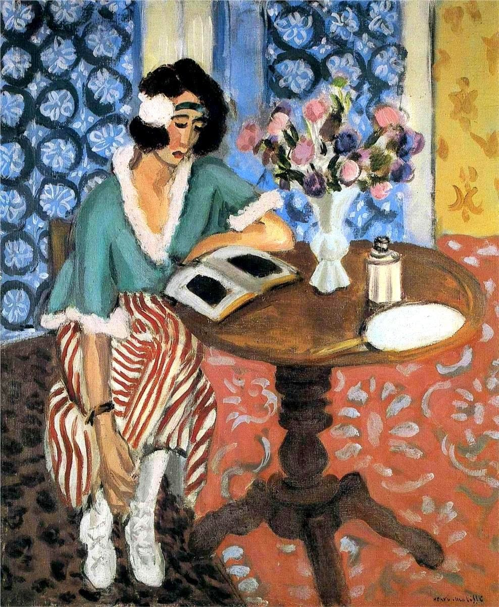 Woman Reading at a Small Table (c.1923). Henri Matisse (French, 1869-1954). Oil on canvas. Kunstmuseum Bern.