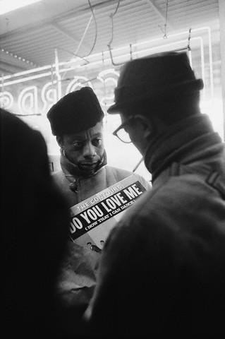 James Baldwin    in Harlem, 1963. Photo by Steve Schapiro.