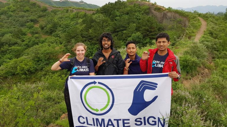 Climate Sign from Great Wall of China with OYE and IYSECC participants