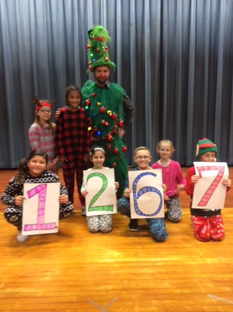 Students at Hendy Elementary School collected over 1,000 books to donate to the Bright Red Bookshelf. As a result, their principal dressed up as a Christmas Tree!