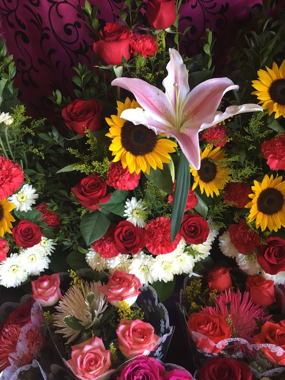 We have so many fresh flower arrangements, bouquets and fixtures to choose from!