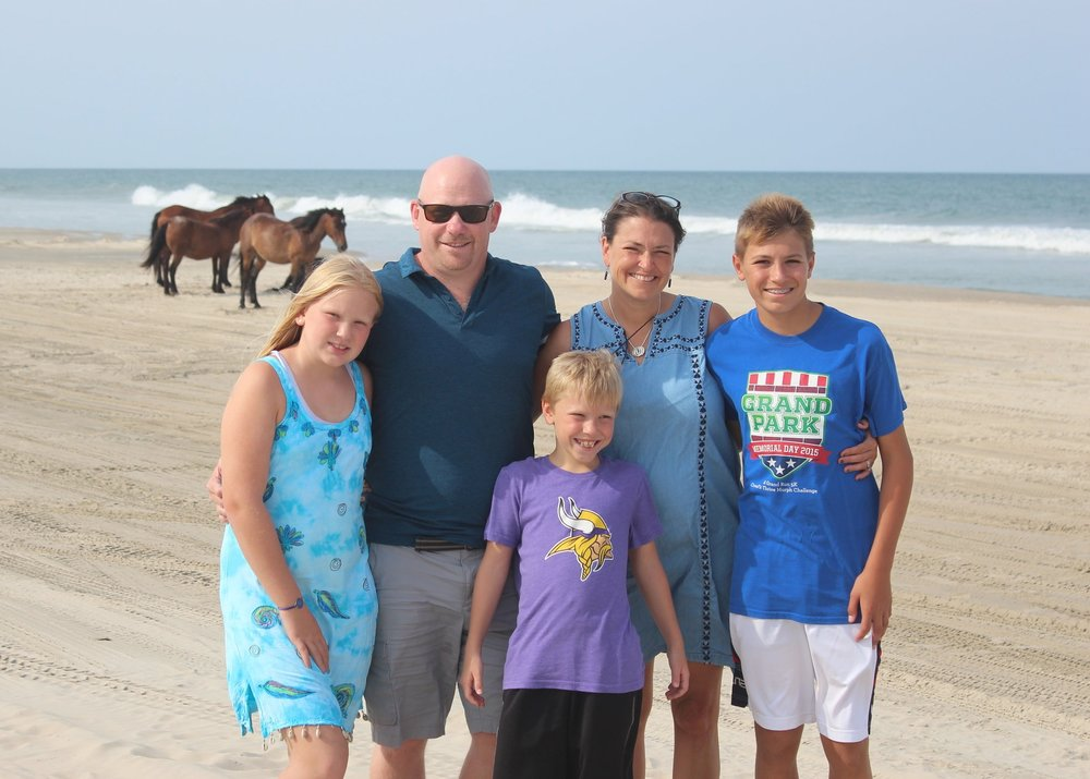 Vacation in Corrolla, NC - 2017 family photo in front of the wild horses