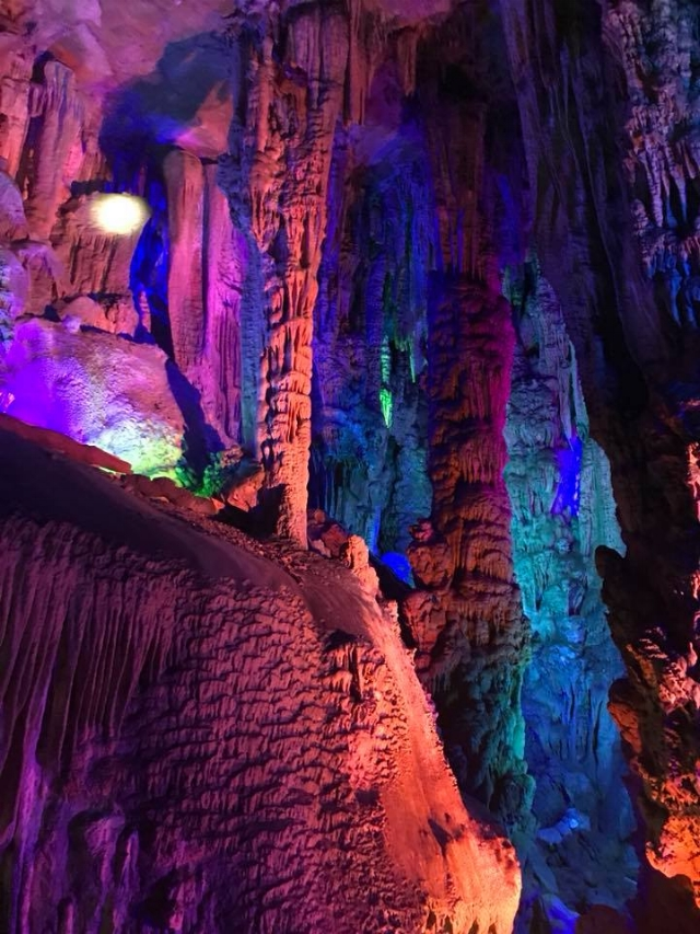 Reed Flute Cave - After we landed in Guilin, our tour guide drove us to the Reed Flute Cave. This vast cave lights up the diverse stalagmites and stalactites with multi-color lighting. It was an okay adventure, but not my favorite. The narration for our guided tour through the cave, so being that this was just our third day in China we hadn't yet mastered the language. Stalactites and stalagmites don't require much explanation, especially if you have been to Ruby Falls, you know this stuff. Moving on...