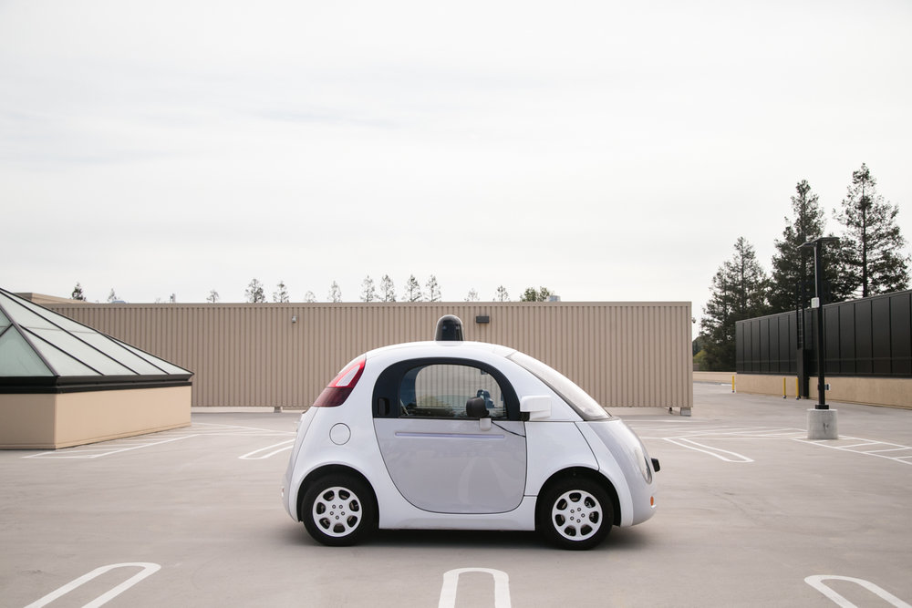 A prototype self-driving car is seen on the roof of a Google campus building in Mountain View, California