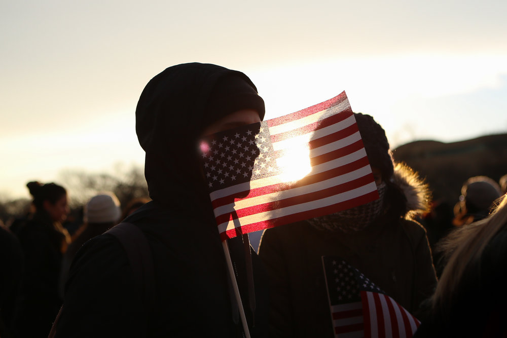 A man holds an American flag during the second inauguration of President Barack Obama in Washington, D.C.
