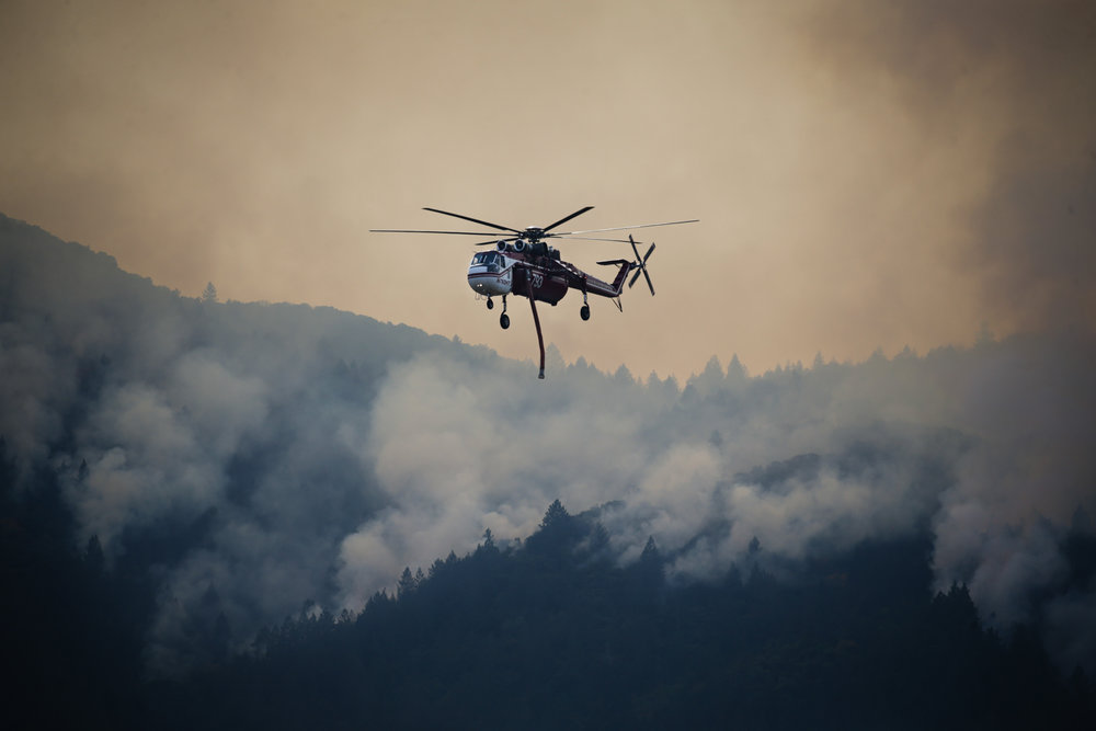 Tanker helicopters fight a wildfire in Oakville, California