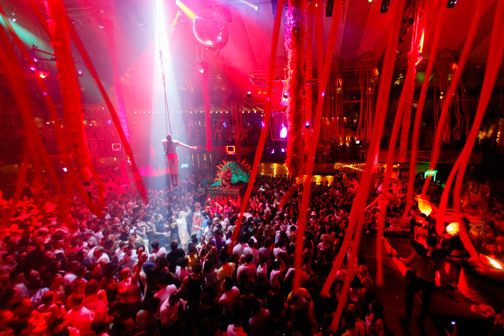 An aerial artist performs at Amnesia in Ibiza, Spain