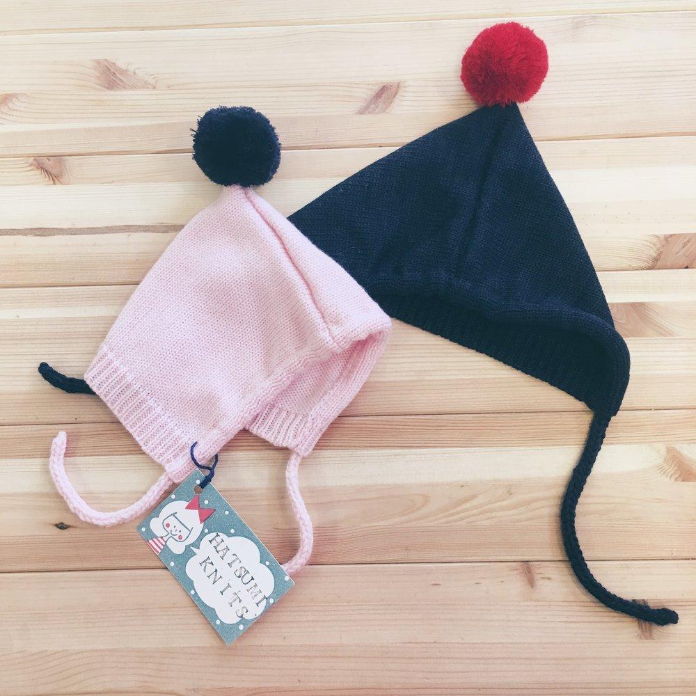 hatsumi knits pompom adorned, baby bonnets