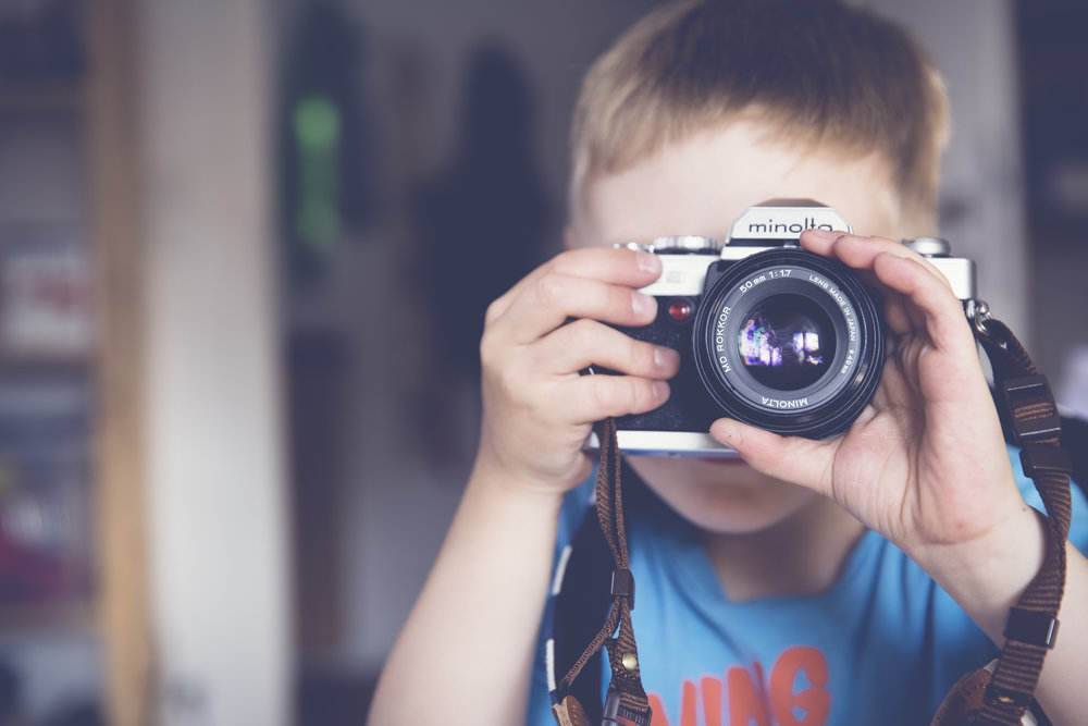 kid with camera.jpeg