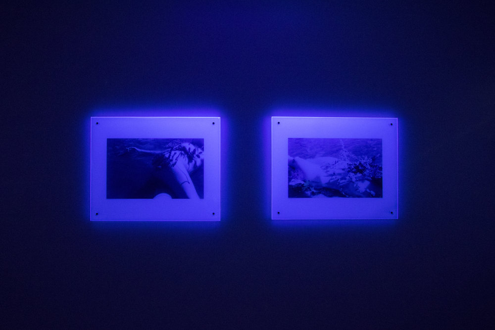 Because of the fluorescence of the acrylic the images don't show the original fluorescent hues caused by the film stock.
