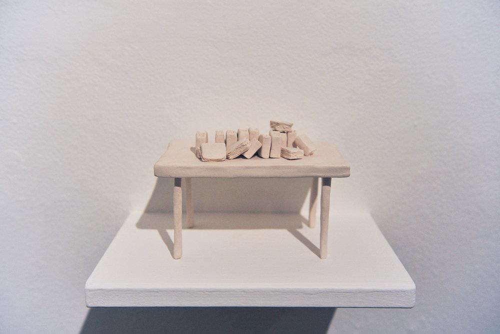 Tavolo con faldoni , 2016, porcelain, cm 15x10x12