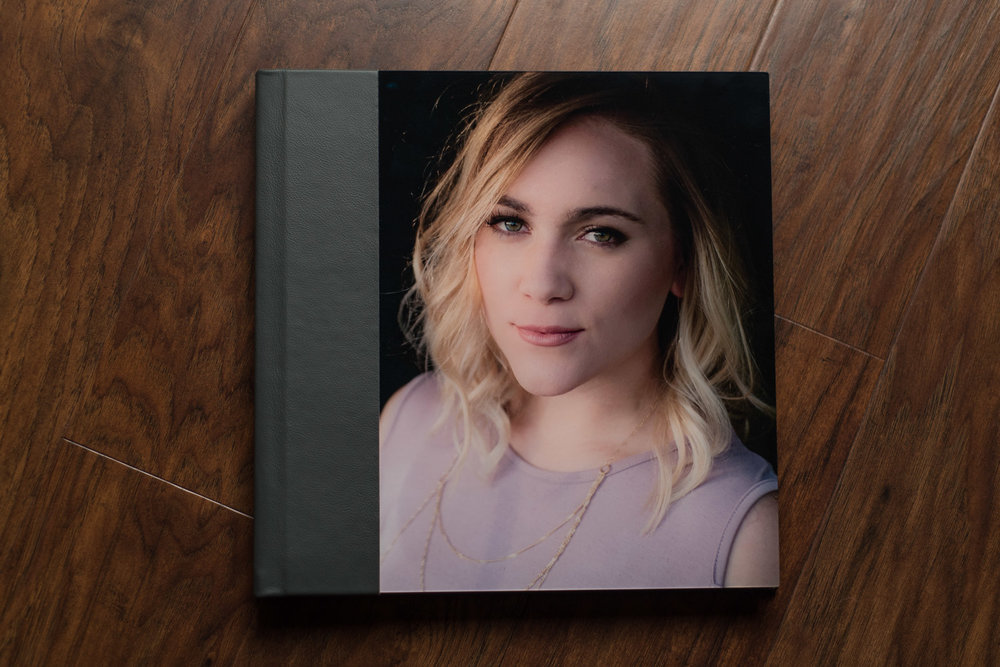 This is a 10x10 Signature Album, featuring an acrylic cover with leather wrap and layflat spreads. It's sure to be a keepsake you'll cherish for generations to come.