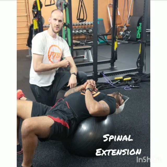 We've covered thoracic extension before, but we used a foam roller primarily. Today we'll cover an alternative using an exercise ball to create some spinal extension in a softer, morecontrolled environment. This is also a great stretch to open up after a long period of sitting/working in front of a computer. . 1. Lie Back on Ball - try to place ball somewhere in the middle of your spine while maintaining a comfortable position. You shouldn't feel like you might roll off or lose control. . 2. Extend Arms Overhead to Increase Lat Stretch - Just leaning back and extending over the ball should do the trick to extend your spine, but if you want to add in a little Lat work try raising arms and let them fall back. . 3. Let Everything Relax and Focus on Controlled Breathing - Once you've gotten into position, really let yourself relax. Allow yourself to go deeper into the stretch and focus on controlling and relaxing your breathing. . Hold this stretch for around 30 seconds for 2-3 sets. Give it a try after a long day at work or to open up before a workout!