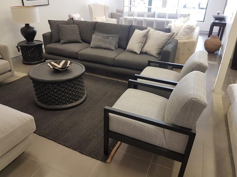 Soho 3.5 sofa with customised metal leg powder coated to spec. Pair of Conran chairs custom stained matt black.  Hunt & Design
