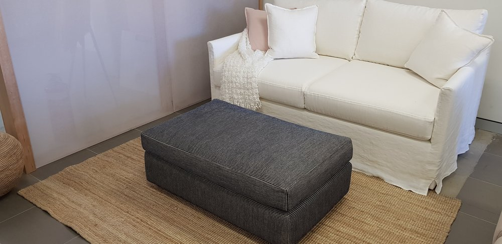 Queen size sofa bed with additional linen slipcover